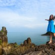 Teen-girl in a blue dress in the rocks of the coast of the island of Koh Chang in Thailand. — Stock Photo #24704711