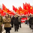 MOSCOW - MAY 1: Communist party supporters take part in a rally marking the May Day, May 1, 2013 in Moscow, Russia - Stock Photo