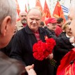 Stock Photo: MOSCOW - MAY 1: Communist party supporters take part in a rally marking the May Day, May 1, 2013 in Moscow, Russia