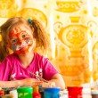 Stok fotoğraf: Child drawing paint with paint of face