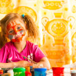 Стоковое фото: Child drawing paint with paint of face