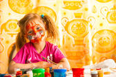 Child drawing paint with paint of face — Stock Photo