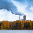 Air pollution by smoke coming out of three factory chimneys — Stock Photo