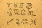 Set of zodiac signs - drawn on the facture beach sand. — Zdjęcie stockowe