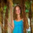 Teengirl in a blue dress in mangrove forest. — Stock Photo #25880465