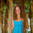 Stock Photo: Teengirl in blue dress in mangrove forest.