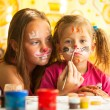 Sisters playing with painting — Stockfoto