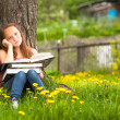Tired teengirl with books in the village — Stock Photo