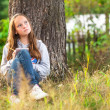 Teenage girl with notebook in park — Stock Photo #25935907