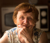 An old woman at her home — Stock Photo
