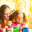 Sisters playing with painting — Stock Photo