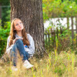 Foto Stock: Teenage girl in park