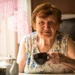 Portrait an elderly woman at her home — Stock Photo