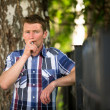 Man smoking outdoors — Stock Photo
