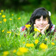 Portrait of a teen girl lying in the grass — Stock Photo