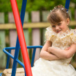 Portret of lovely girl on the playground in the village — Stockfoto
