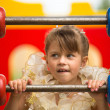 Stock Photo: Portrait of baby girl on playground.