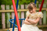 Portret of lovely girl on the playground in the village — Stock Photo