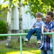 Father and son on the playground — Stock Photo #26370177