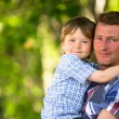 Portrait of father and son outdoors — Stockfoto