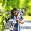 Foto Stock: Father and son playing in the park