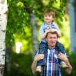 Portrait of father and son outdoors — Stockfoto #26370501