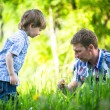 Father and son playing in the park. — Stock Photo
