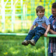 Father and son playing on the playground — Stock Photo #26855139