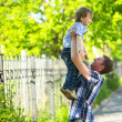 Foto Stock: Portrait of father and son playing outdoors