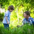 Portrait of father and son play outdoors in the park — Стоковое фото
