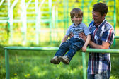 Father and son playing on the playground — Stock Photo