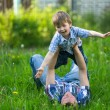 Father with his small son playing in the grass — Stock Photo