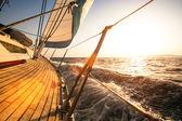 Sailing regatta, during sunset. — Stock Photo