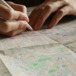 Hand makes notes with pencil on the map — Stok video