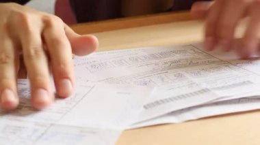 Women's hands revises paper bills