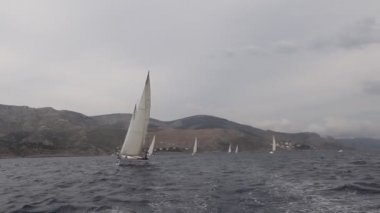 PELOPONNESE, GREECE- MAY 8: Boats Competitors During of 9th spring sailing regatta Ellada 2013, May 8, 2013 in Peloponnese, Greece. — Stock Video #27511015