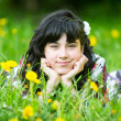Portrait of a young pretty girl in the park — Stock Photo #27529895