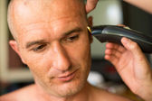 Close-up: Adult man being shaved at the hair salon. — Stock Photo