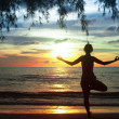 Young woman practicing yoga on the beach in the Siam Gulf during the sunset. — Stock Photo