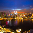Stock Photo: Night scene of financial district Singapore from roof MarinBay Hotel
