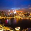 Night scene of financial district Singapore from roof Marina Bay Hotel — Stock Photo