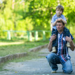 Stock Photo: Portrait of father and son outdoors