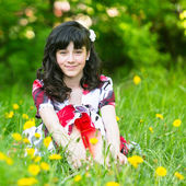 A young pretty girl sitting in the grass — Stock Photo