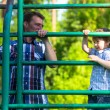 Stock Photo: Father and son playing on the playground.