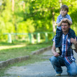 Portrait of father and son in the park. — Стоковое фото