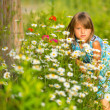Charming little girl among yellow wildflowers — Stock Photo