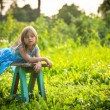 Charming little girl in the yard of a country house — Stock Photo #28910789