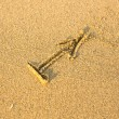 Stock Photo: Zodiac sign Sagittarius, drawn on facture beach sand.