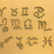 Stock Photo: Set of zodiac signs (drawn on the facture beach sand)