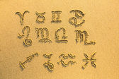 Set of zodiac signs (drawn on the facture beach sand) — Zdjęcie stockowe